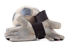 Soccer goalkeeper's gloves and the ball. Isolated on white background royalty free stock images
