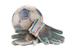 Soccer goalkeeper's gloves and the ball. Isolated on white background stock image