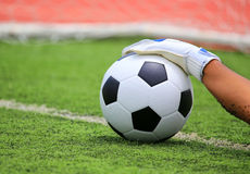 Soccer goalkeeper's hands reaching for the ball Royalty Free Stock Image