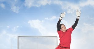 Soccer goalkeeper saving in goal. Digital composite of Soccer goalkeeper saving in goal stock images