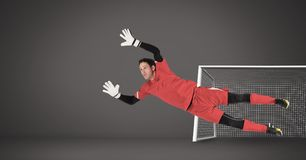 Soccer goalkeeper saving in goal royalty free stock photography