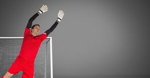 Soccer goalkeeper saving in goal. Digital composite of Soccer goalkeeper saving in goal stock image