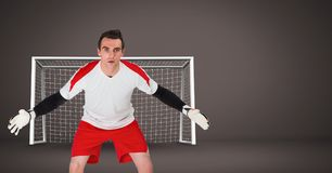 Soccer goalkeeper saving in goal. Digital composite of Soccer goalkeeper saving in goal royalty free stock photo