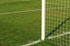 Soccer goalpost. Close-up on goalpost in soccer field Royalty Free Stock Photography