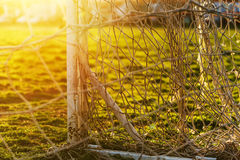 Soccer goalpost and net on practicing pitch Stock Images