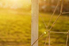 Soccer goalpost and net on practicing pitch Royalty Free Stock Images