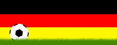 Soccer on grass in front of Germany colors Royalty Free Stock Photo