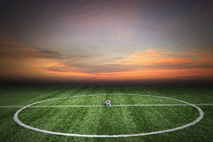 Soccer green grass field at sunset Royalty Free Stock Photos