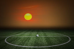 Soccer green grass field at sunset Stock Image