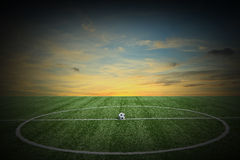Soccer green grass field at sunset Royalty Free Stock Photography