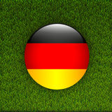Soccer green grass pattern field with Germany flag Royalty Free Stock Photo