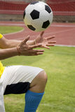 Soccer'hands reaching the foot ball Royalty Free Stock Photos