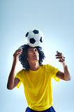 Soccer header. Soccer fotball player header ball with skill Stock Image