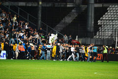Soccer hooligans invason on the soccer field Royalty Free Stock Photo