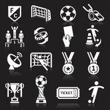 Soccer icons on black background. Stock Image