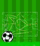 Soccer illustration. Tactics plan and grungy soccer ball, free copy space Stock Image