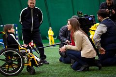 Soccer interview child girl invalid tv. Interview child football soccer invalid disabled Royalty Free Stock Photo