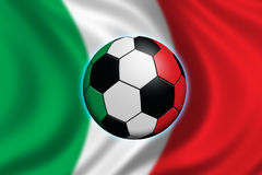 Soccer in Italy. Soccer ball and italian flag (flag out of focus Royalty Free Stock Photo