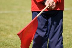 Soccer judge with red flag Royalty Free Stock Photo
