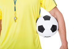 Soccer judge standing with ball Stock Image