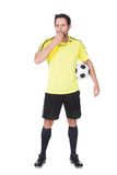 Soccer judge standing with ball Stock Photos