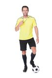 Soccer judge standing with ball Stock Photo
