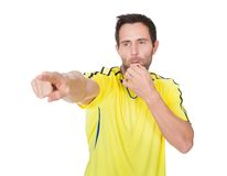 Soccer judge whistling Royalty Free Stock Image