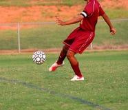 Soccer Kick. Team soccer player kicking the ball Royalty Free Stock Photography