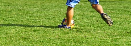 Soccer Kick 3. A person kicking a soccer ball across the field Royalty Free Stock Photo
