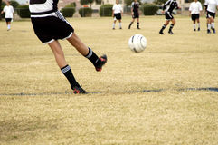 Soccer kick. A penalty kick in a girl's league soccer game Stock Photos