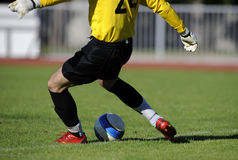 Soccer kick. Soccer or football goalkeeper kick the ball Royalty Free Stock Images