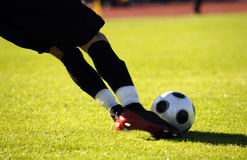 Soccer kick. Soccer or football goalkeeper kick the ball Royalty Free Stock Photography