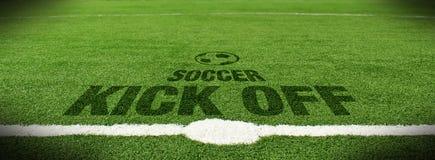 Soccer kick off. Text on green grass Stock Photos