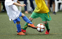 Soccer kids. Little boys fighting for a ball during a soccer match Stock Image