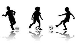 Soccer kids silhouettes Royalty Free Stock Image