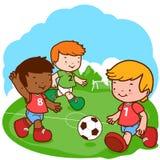 Soccer kids. Three little boys play football Stock Photo