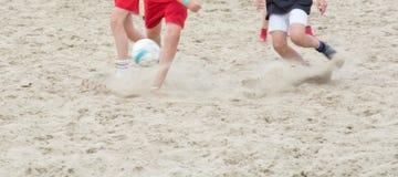 Soccer legs kicking ball Stock Image