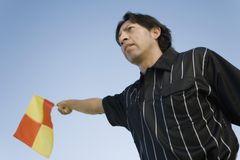 Soccer linesman waving flag Royalty Free Stock Photography