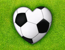 Soccer love. Heart from traditional black white soccer ball on green grass field Stock Illustration