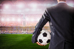 Soccer manager against supporters in the stadium Royalty Free Stock Images