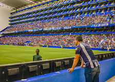 Soccer Match at George Capwell Stadium, Guayaquil, Ecuador. GUAYAQUIL, ECUADOR, NOVEMBER - 2016 - Crowded grandstand at soccer match between Emelec against Liga Royalty Free Stock Photography