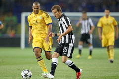 Soccer match metalist vs paok. KHARKIV, UKRAINE -AUG 07:Lazar of PAOK (R) in action with Moledo of METALIST (L) during the UEFA Champions League soccer match Royalty Free Stock Image