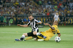 Soccer match metalist vs paok. KHARKIV, UKRAINE -AUG 07:Salpingidis of PAOK (L) in action with Moledo of METALIST (R) during the UEFA Champions League soccer Stock Images