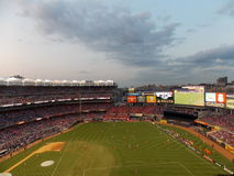Soccer Match at Yankee Stadium. A wide shot of Yankee Stadium in New York City at sunset, as it hosts a soccer match between England's Liverpool Football Club Stock Photography