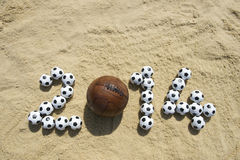 Soccer 2014 Message in Beach Sand with Vintage Football Stock Images