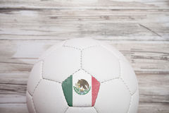 Soccer: Mexican Soccer Ball Background For International Competition. Series with a soccer ball with a country`s flag symbol on a panel stock photography