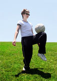 Soccer mom. Woman on a soccer field Stock Photography