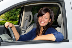 Soccer Mom. Beautiful Young Mother At The Wheel Of Her Sport Utility Vehicle Stock Photography