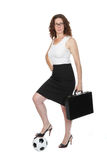 Soccer Mom or Business Woman?. Woman in business attire with briefcase and one foot on a soccer ball (futbol Stock Photography