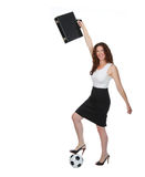 Soccer Mom or Business Woman. Smiling business woman holding a briefcase overhead with one foot on a soccerball Stock Images